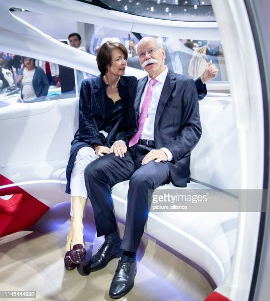 Dieter Zetsche outgoing Chairman of the Board of Management of Daimler AG sits with his wife Anne in Vision Urbanetic Konzeptbus in the vehicle...