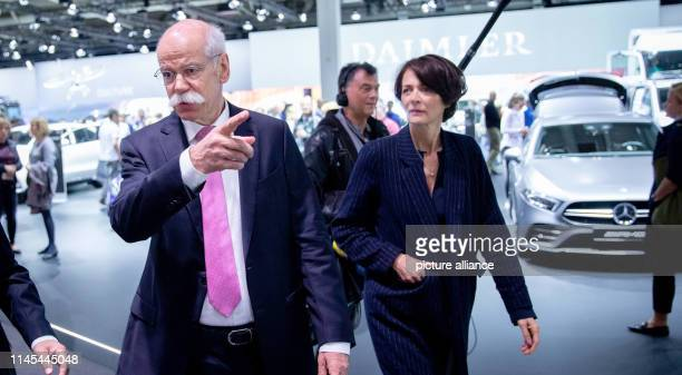 Dieter Zetsche outgoing Chairman of the Board of Management of Daimler AG visits the vehicle exhibition with his wife Anne at the beginning of the...