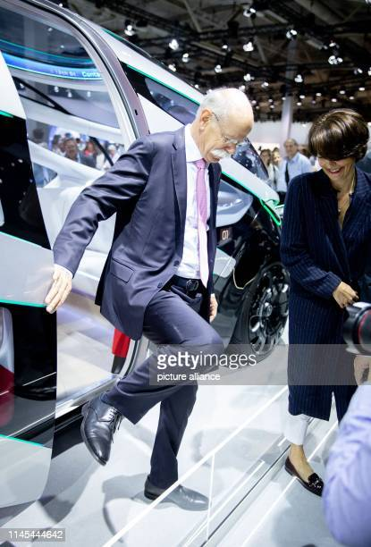 Dieter Zetsche retiring Chairman of the Board of Management of Daimler AG and his wife Anne get off a Vision Urbanetic concept bus at the beginning...