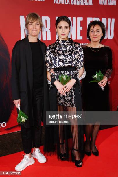 """Director Sherry Hormann , actor Almila Bagriacik and producer Sandra Maischberger come to the premiere of """"Nur eine Frau"""" at Kino International. The..."""