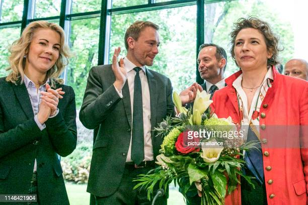 Linda Teuteberg , FDP Secretary General, and Christian Lindner, Federal Chairman of the FDP, applaud Nicola Beer, the FDP's top candidate in the...