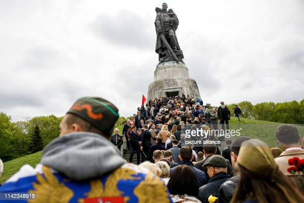People visit the Soviet Memorial in Treptower Park to mark the 74th anniversary of Russia's victory in the Second World War. Russia celebrates the...