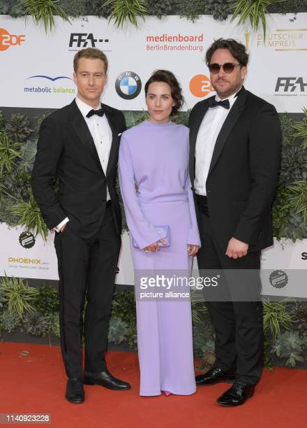 The actors Alexander Fehling Ronald Zehrfeld and Christina Hecke come to the 69th German Film Award Lola Photo Jörg Carstensen/dpa