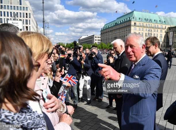 The British Prince Charles speaks to spectators in front of the Brandenburg Gate alongside Michael Müller , Governing Mayor of Berlin. Photo: Bernd...