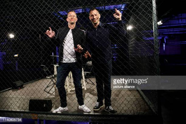 The writers Sebastian Fitzek and Vincent Kliesch read in front of an audience in a cage at the event for the world premiere of the radio play...