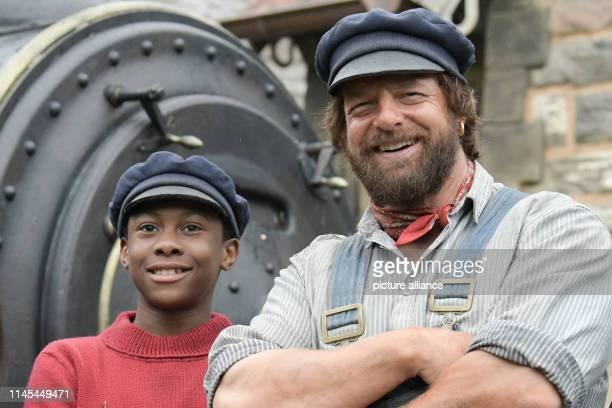 """May 2019, Brandenburg, Potsdam: The actors Solomon Gordon and Henning Baum stand side by side during the shooting of """"Jim Knopf und die Wilde 13""""...."""