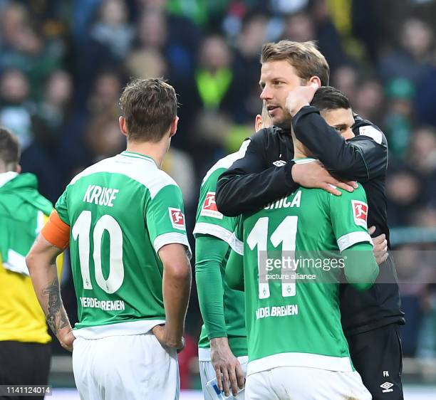 Soccer Bundesliga Werder Bremen Borussia Dortmund 32nd matchday Werder coach Florian Kohfeldt embraces Milot Rashica after the end of the game and...