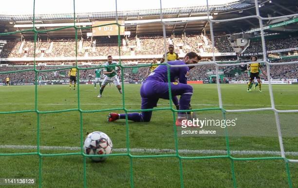 Soccer Bundesliga Werder Bremen Borussia Dortmund 32nd matchday in Weserstadion Goalkeeper Roman Bürki from Dortmund let the ball slide through his...