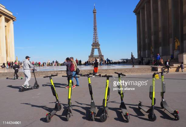 Electric pedal scooters are available for rent on the Place du Trocadéro in the background you can see the Eiffel Tower Scooters with electric motors...