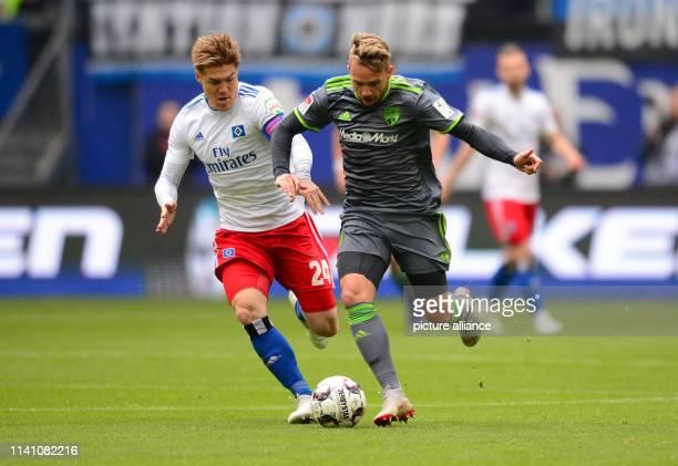 Soccer 2nd Bundesliga 32nd matchday Hamburger SV FC Ingolstadt 04 in the Volksparkstadion Hamburg's Gotoku Sakai and Ingolstadt's Thomas Pledl fight...
