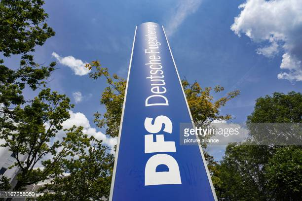 May 2019, Hessen, Frankfurt/Main: A sign at the entrance to DFS Deutsche Flugsicherung GmbH stands in front of the company headquarters in southern...