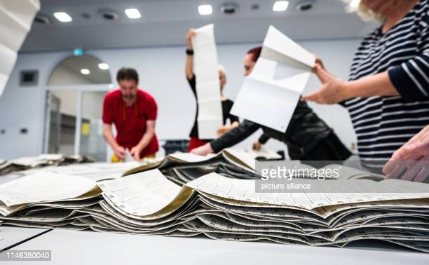 Election assistants lay out the ballot papers for the European elections on the counting table in order in the town hall From 23 May to 26 May the...