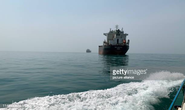 Iranian oil and cargo ships in the Persian Gulf in front of the Strait of Hormus Almost a third of the world's oil exports are shipped through the...
