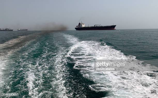 Iranian oil and cargo ships in the Persian Gulf in front of the Strait of Hormus. Almost a third of the world's oil exports are shipped through the...