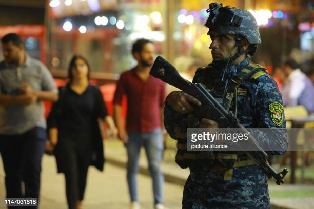 A member of the Iraqi federal police forces takes part in security measures at a checkpoint Iraqi forces imposed tight security measures and deployed...