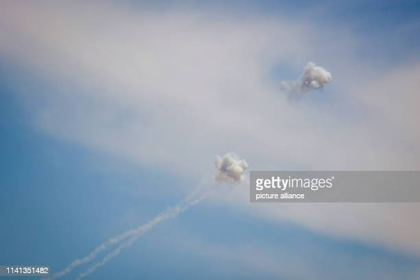May 2019, Israel, Netiv HaAsara: Rockets fired from Gaza are being intercepted by Israel's Iron Dome air defence system. Israeli Prime Minister...
