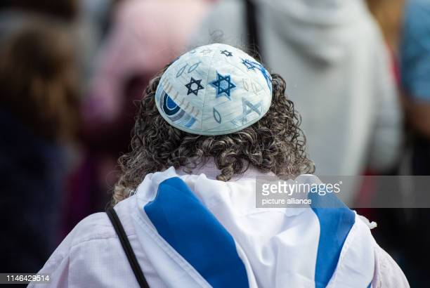 A woman is wearing a kippa at a rally of an alliance against antiSemitism In the night from 17 to 18 May an antiSemitic arson attack took place in...
