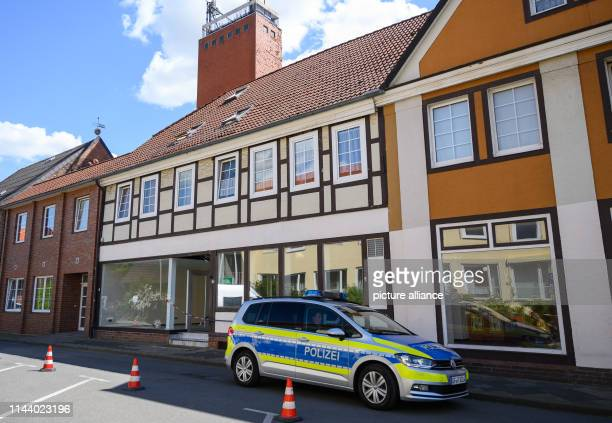 A police car drives past a house in which two bodies were found in connection with the Passau crossbow case The dead women had been discovered in the...