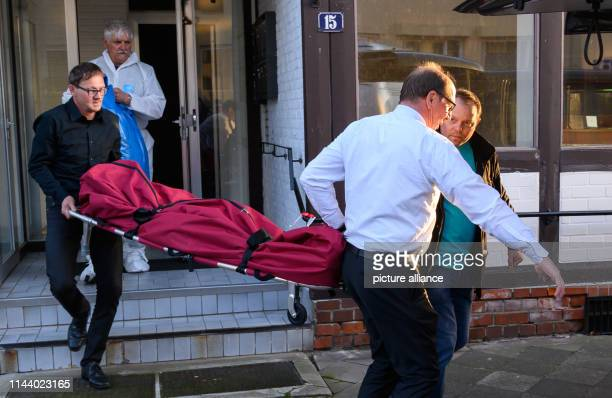 Undertakers carry a body in a body bag In connection with the Passau crossbow case investigators have found two bodies in Lower Saxony The dead women...