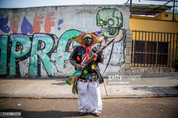 A man poses with his rifle in front of a mural as part of a reenactment of the Battle of Puebla In the battle of Puebla Mexican troops defeated the...