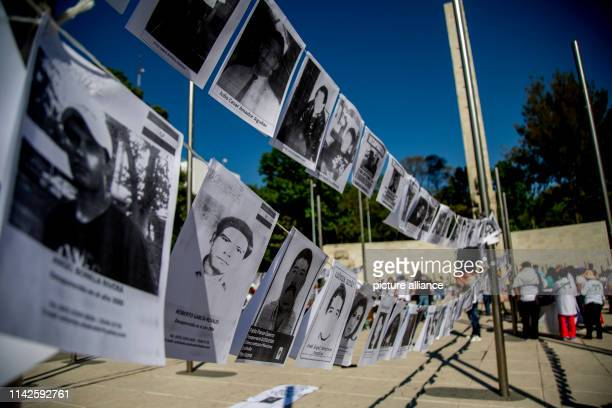 Images of kidnapped people hanging in front of the mother's monument in Mexico at the edge of a protest to see On Mexican Mother's Day numerous women...