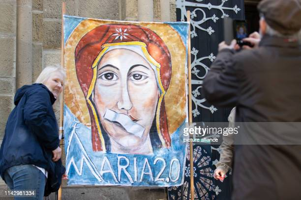 11 May 2019 North RhineWestphalia Münster A banner shows Mary the Mother of God with a plaster on her mouth during an openair service Catholic women...
