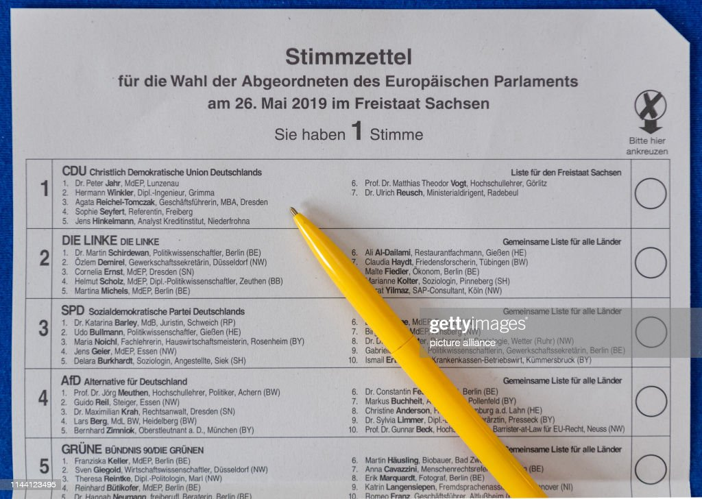 ILLUSTRATION - A pen is on a ballot paper for the postal