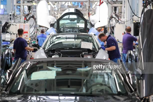 Employees at the BMW plant in Leipzig work on the assembly of the i8 The plugin hybrid sports car has been built at BMW's Leipzig plant since 2013...