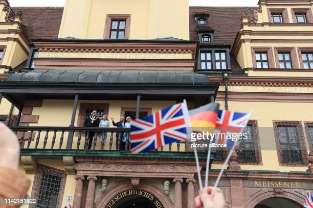The British heir to the throne Prince Charles and his wife Camilla stand with Burkhard Jung mayor of Leipzig and his wife Ayleena on the balcony of...