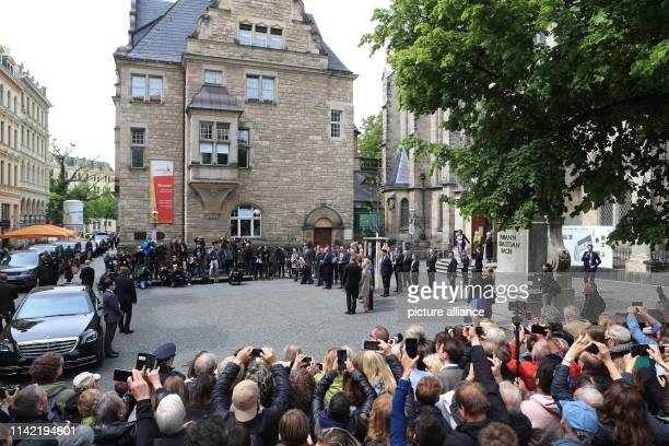 The British heir to the throne Prince Charles and his wife Camilla are welcomed at the Thomaskirchhof by Michael Kretschmer Prime Minister of Saxony...