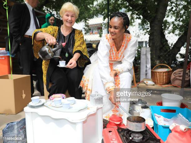 Sabine Schmolke and Mihret Goitom from Erita roast coffee together at the meeting celebration The Police Directorate SaxonyAnhalt North Churches and...