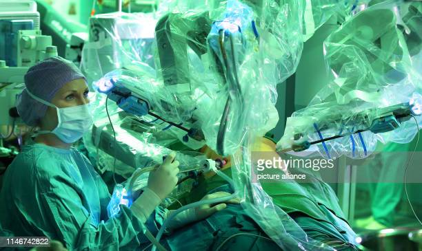Vivien Schacke assistant physician for surgery at the University Hospital Magdeburg sits during an operation on the pancreas of a female patient at...