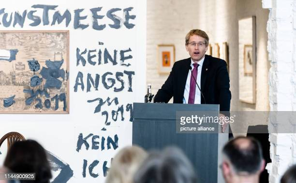Daniel Günther Minister President of SchleswigHolstein opens the International Museum Day at the StAnnenMuseum on which museums throughout Germany...
