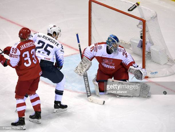 Ice hockey World Championship Denmark USA preliminary round Group A 5th matchday in the Steel Arena Denmark goalkeeper Simon Nielsen parries the shot...