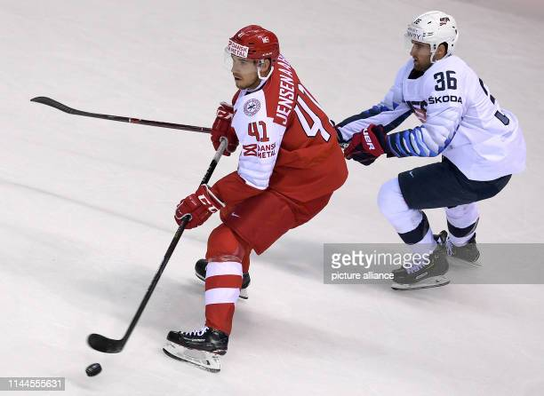Ice hockey World Championship Denmark USA preliminary round Group A 5th matchday in the Steel Arena Denmark's Jesper Jensen Aabo and Colin White from...