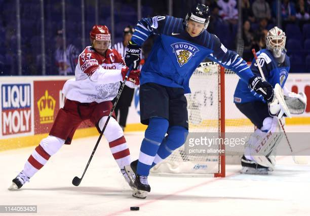 Ice hockey World Championship Finland Denmark preliminary round Group A 4th matchday in the Steel Arena Denmark's Peter Regin and Finland's Niko...