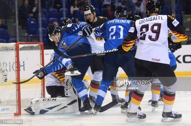 Ice hockey World Championship Finland Germany preliminary round Group A 7th matchday in the Steel Arena Finland's Niko Ojamaki and Juhani Tyrvainen...