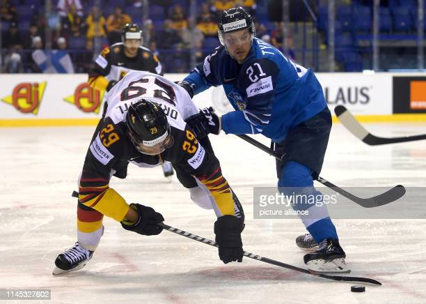 Ice hockey World Championship Finland Germany preliminary round Group A 7th matchday in the Steel Arena Finland's Juhani Tyrvainen and Germany's Leon...