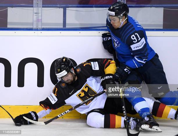 Ice hockey World Championship Finland Germany preliminary round Group A 7th matchday in the Steel Arena Germany's Marco Nowak and Finland's Juho...