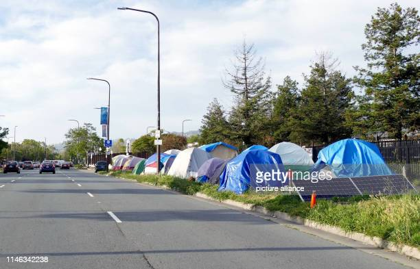Cars drive past the Berkeley Tent City on the edge of Adeline Street The tech boom in San Francisco and neighboring Silicon Valley has provided the...