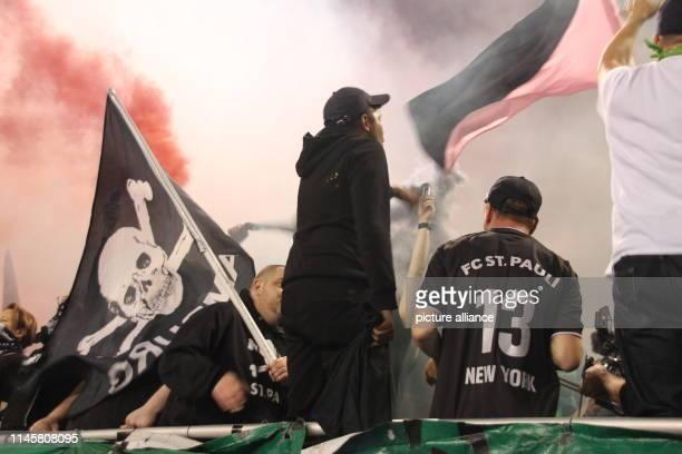 Football friendly New York Cosmos FC St Pauli Fans of FC St Pauli stand with a flag at a friendly match of their club against New York Cosmos The...