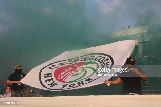 Football friendly New York Cosmos FC St Pauli Fans hold a banner with the merging coats of arms of both clubs The second division football team C St...