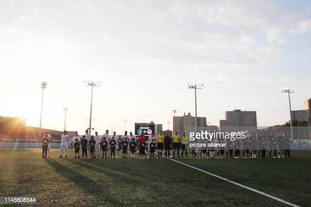Football friendly New York Cosmos FC St Pauli The players of both teams Cosmos on the left St Pauli on the right stand in the evening light with...