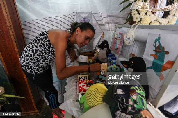 Jennifer Guerrero mother of 11yearold Erick Altuve stands at her child's coffin Erick died waiting for a bone marrow transplant The recent death of...