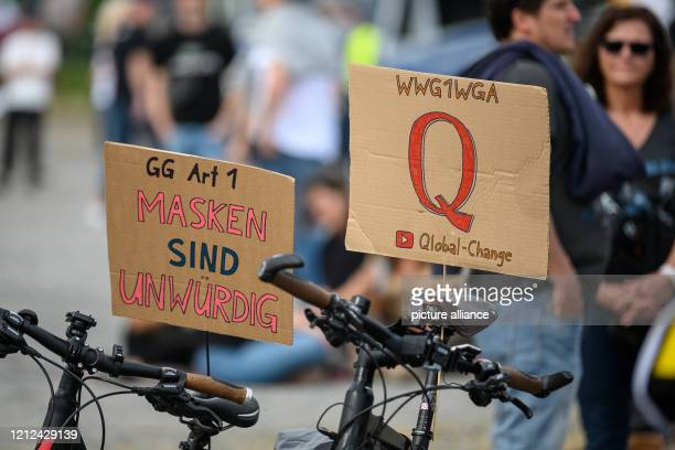 09 May 2020 BadenWuerttemberg Stuttgart Signs with the inscription GG Art1 Masks are unworthy and WWG1WGA as well as the letter Q are on signs during...
