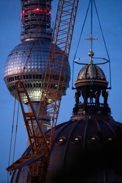 DEU: Berlin Humboldt Forum Receives Cross On The Dome