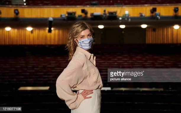 Actress Brigitte Zeh stands with a protective mask during a photo shoot on the stage of the Komödie am Kurfürstendamm The theatre is closed during...