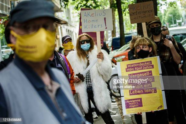Demonstrators protest before the Berlin Administrative Court. The protest accompanies the filing of a lawsuit against the Berlin Senate for delaying...