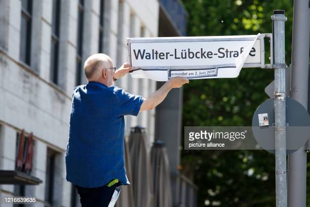 """Members of the International Auschwitz Committee stick the inscription """"Walter-Lübcke-Straße"""" on a street sign in Sigismundstraße for the symbolic..."""
