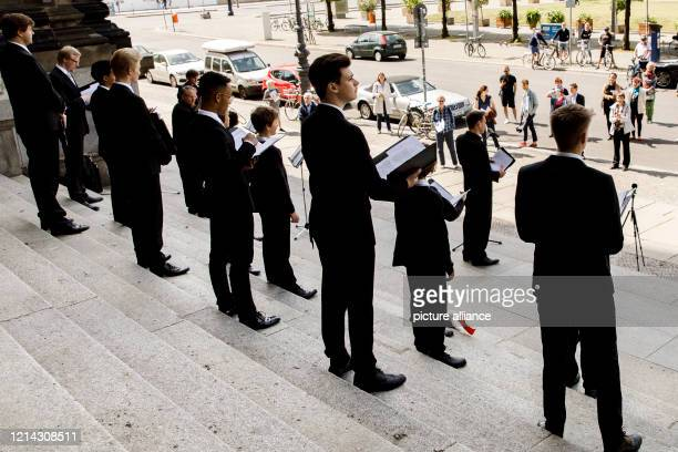 """Members of the Staats- und Domchor sing """"Ascension Day"""" on the steps in front of the Berlin Cathedral after a service on the occasion of the..."""